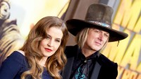 Lisa Marie Presley and Michael Lockwood arrive at the Los Angeles 2015 premiere of 'Mad Max: Fury Road' at TCL Chinese Theatre in Hollywood, California.