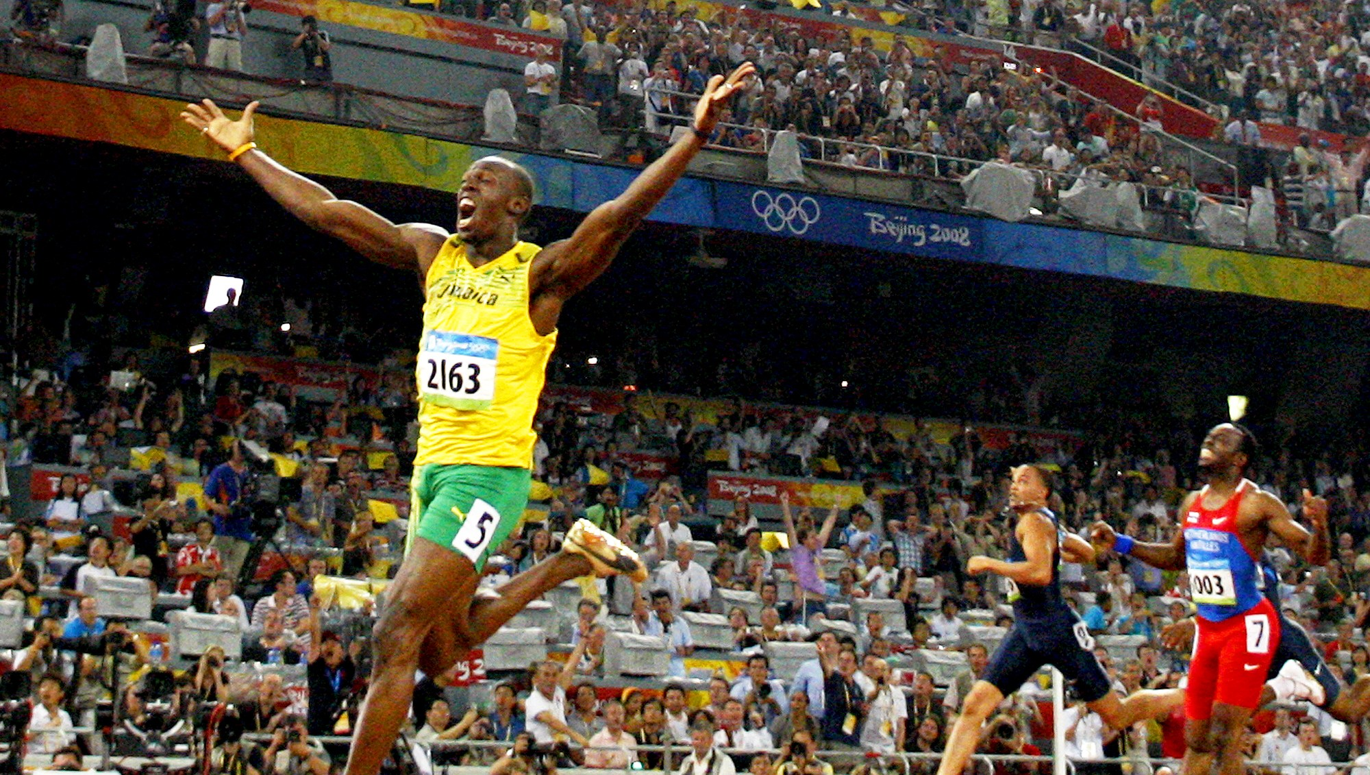 Jamaica's Usain Bolt celebrates winning the men's 200m final at the National stadium as part of the 2008 Beijing Olympic Games on August 20, 2008.