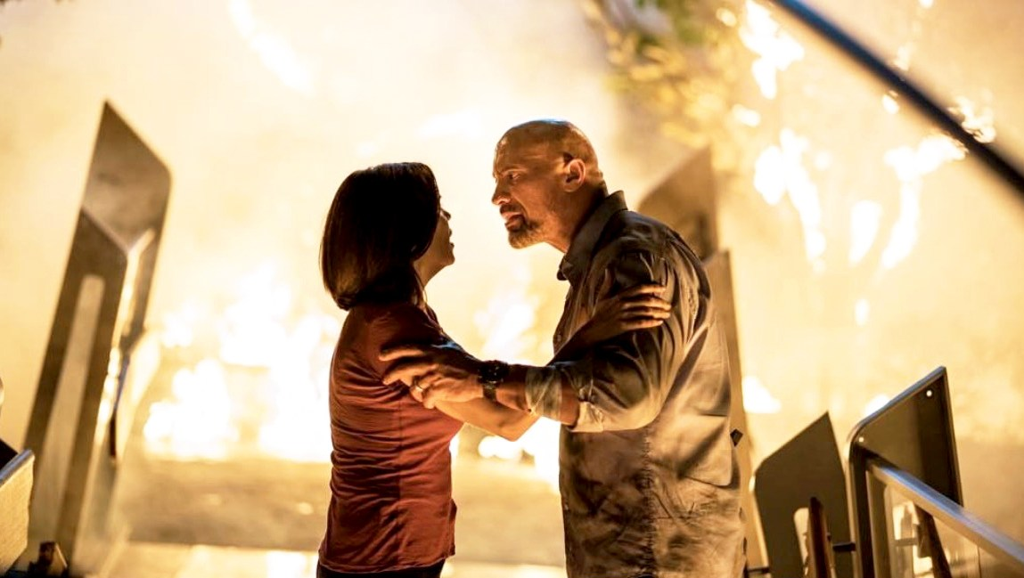 Neve Campbell and Dwayne Johnson in 'Skyscraper'