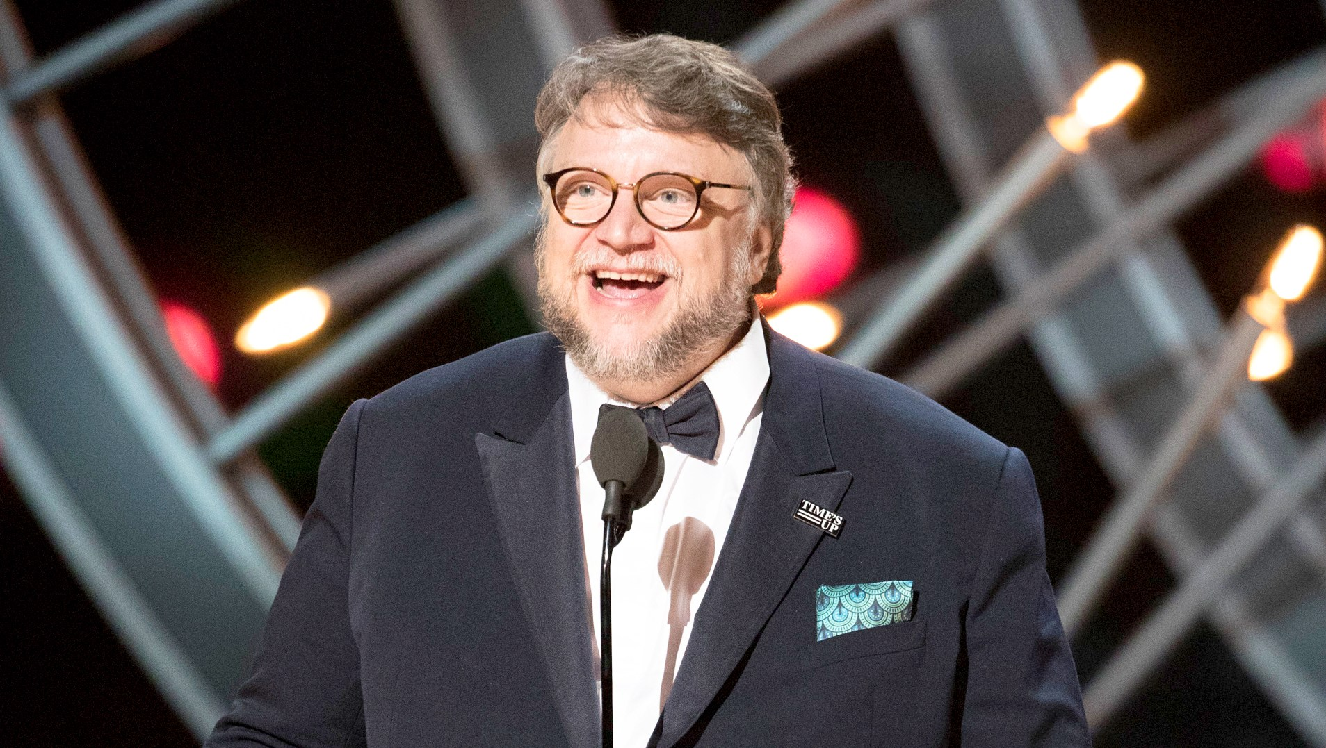 """Mexican director Guillermo del Toro accepts the Oscar for Best Film for """"The Shape of Water"""" during the 90th Annual Academy Awards show on March 4, 2018 in Hollywood, California."""