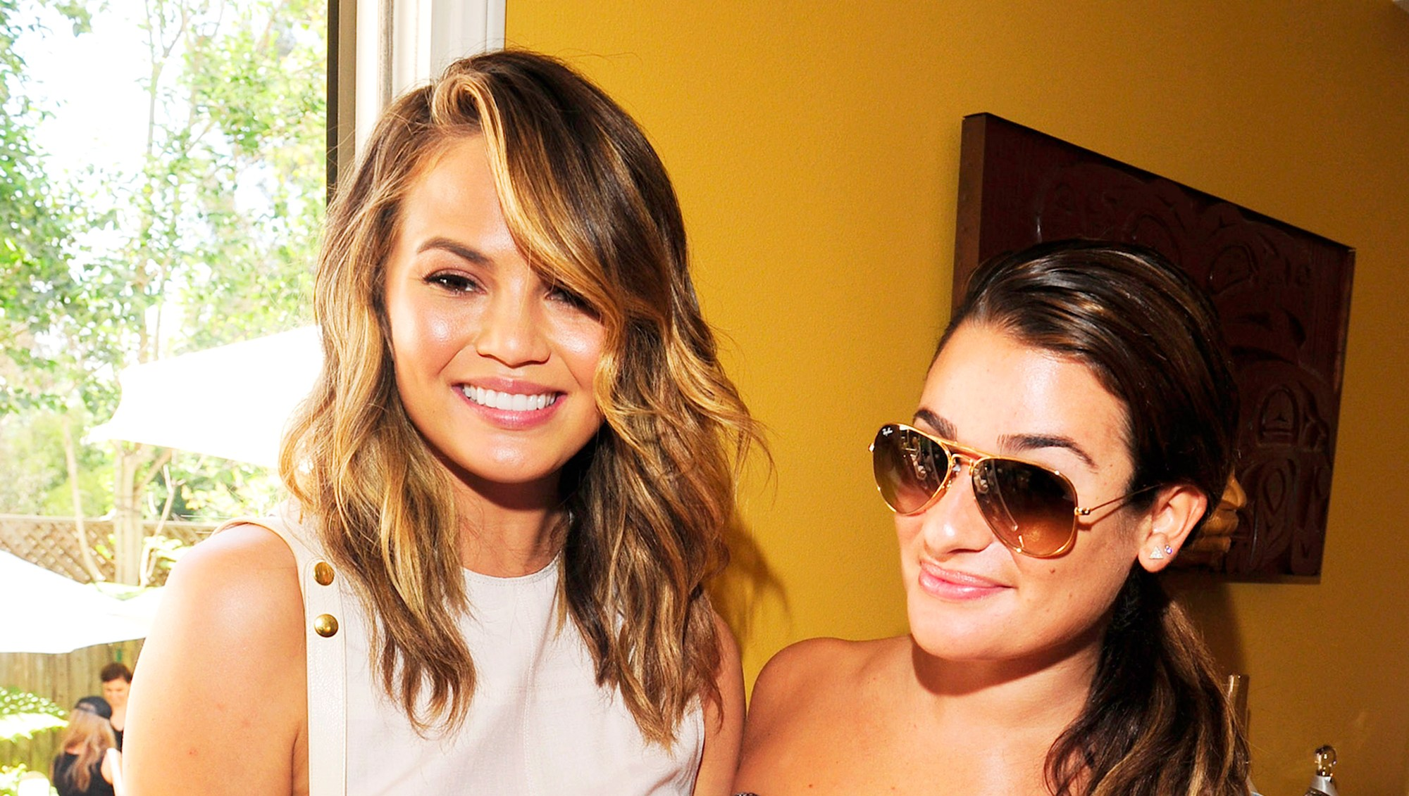 Chrissy Teigen and Lea Michele attend the 2014 Jen Klein Day of Indulgence Party in Los Angeles, California.