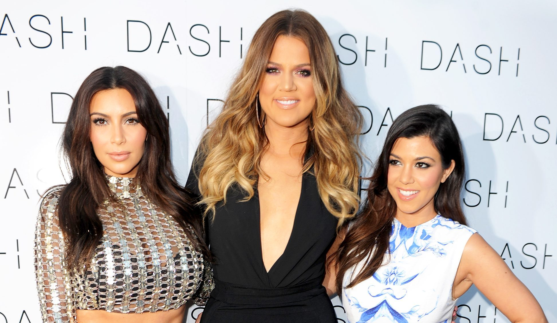 Kim Kardashian, Khloe Kardashian and Kourtney Kardashian attend the 2014 Grand Opening of DASH Miami Beach at Dash Miami Beach in Miami Beach, Florida.