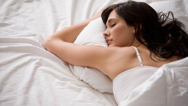 Woman asleep on memory foam mattress
