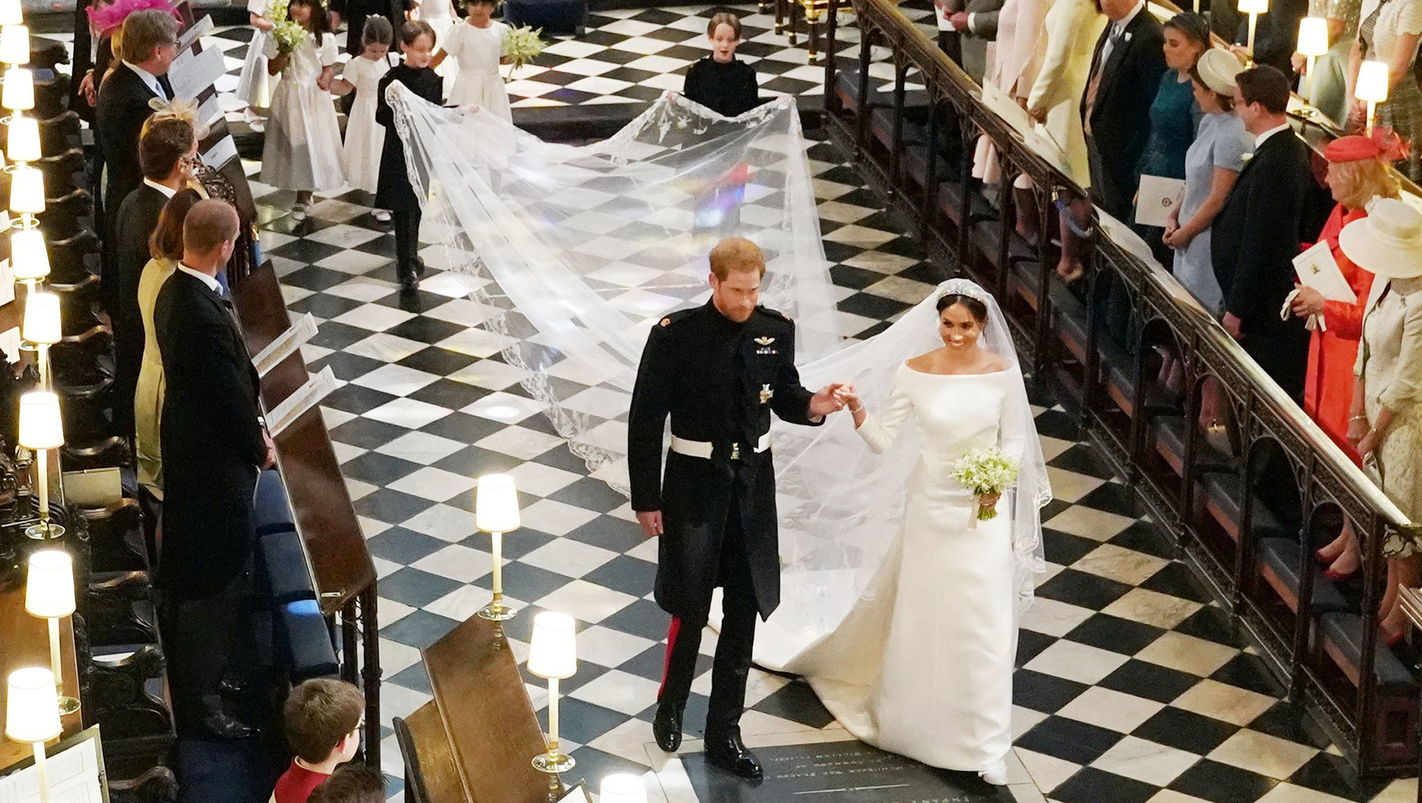 Britain's Prince Harry, Duke of Sussex (L) and Britain's Meghan Markle, Duchess of Sussex, (R) walk away from the High Altar
