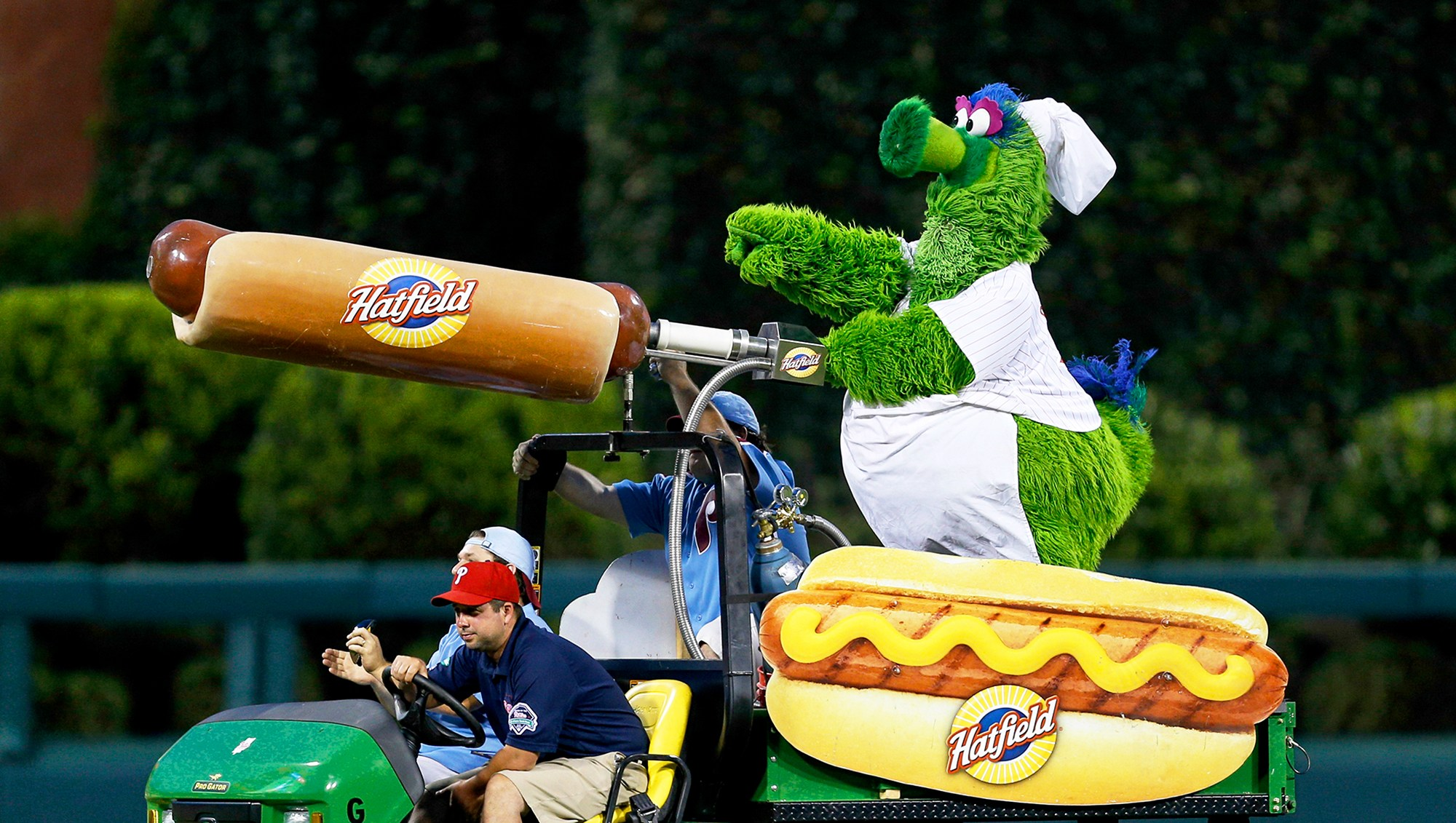 The Philadelphia Phillies mascot the Phillie Phanatic rides a Hatfield Hot Dog cart in the outfield during the game in Philadelphia, Pennsylvania.