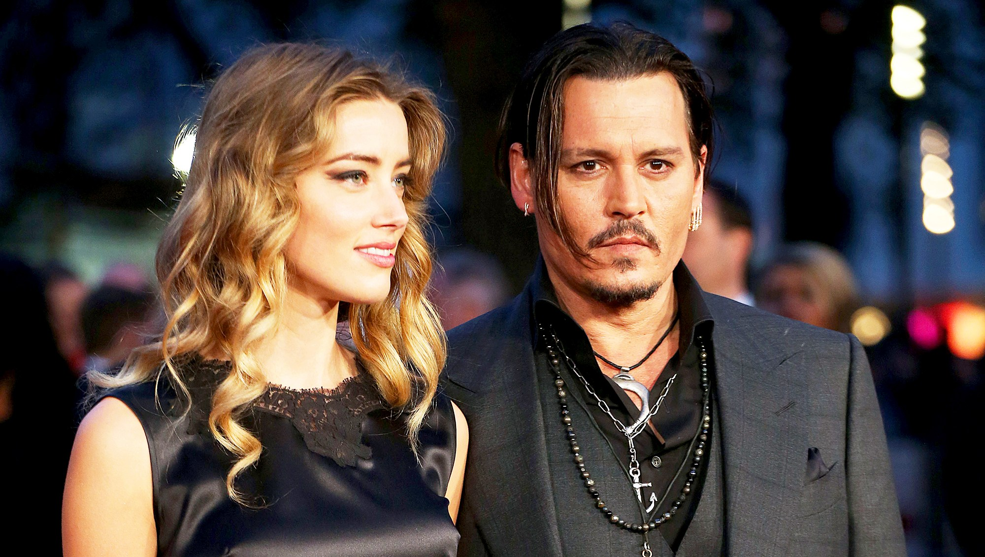 Amber Heard and Johnny Depp attend a screening of 'Black Mass' during the BFI London Film Festival at Odeon Leicester Square in London, England.