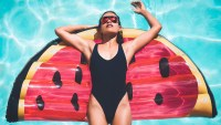 Woman lounging in one-piece swimsuit