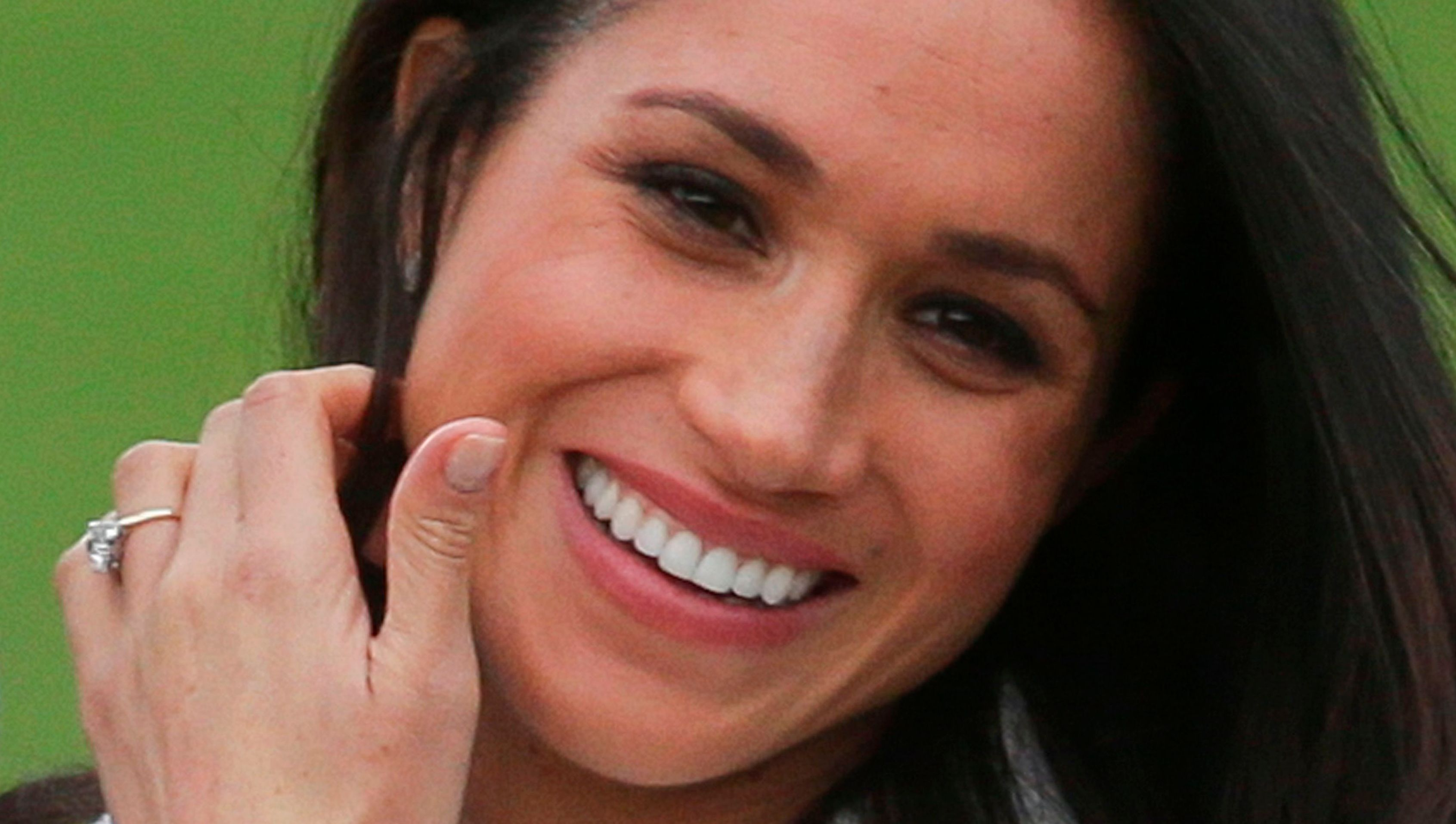 US actress Meghan Markle shows off her engagement ring she poses with her fiancée Britain's Prince Harry in the Sunken Garden at Kensington Palace in west London on November 27, 2017, following the announcement of their engagement. - Britain's Prince Harry will marry his US actress girlfriend Meghan Markle early next year after the couple became engaged earlier this month, Clarence House announced on Monday. (Photo by Daniel LEAL-OLIVAS / AFP) (Photo credit should read DANIEL LEAL-OLIVAS/AFP/Getty Images)