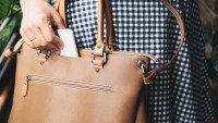 Midsection Of Woman With Purse