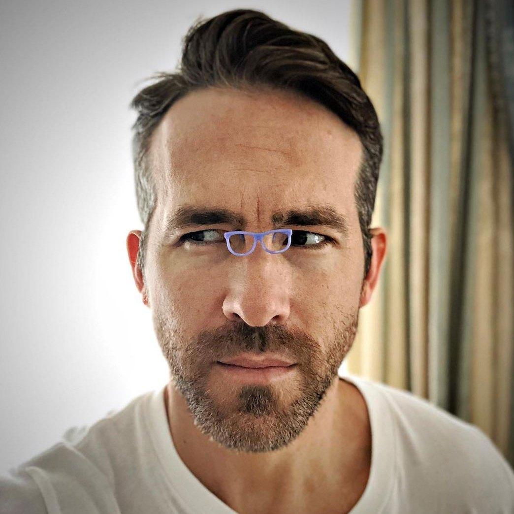 Ryan Reynolds tiny glasses