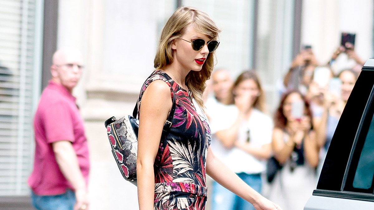 24525cbbe0 Taylor Swift Wears Snakeskin Backpack on Second Anniversary of Kim  Kardashian Calling Her a Snake