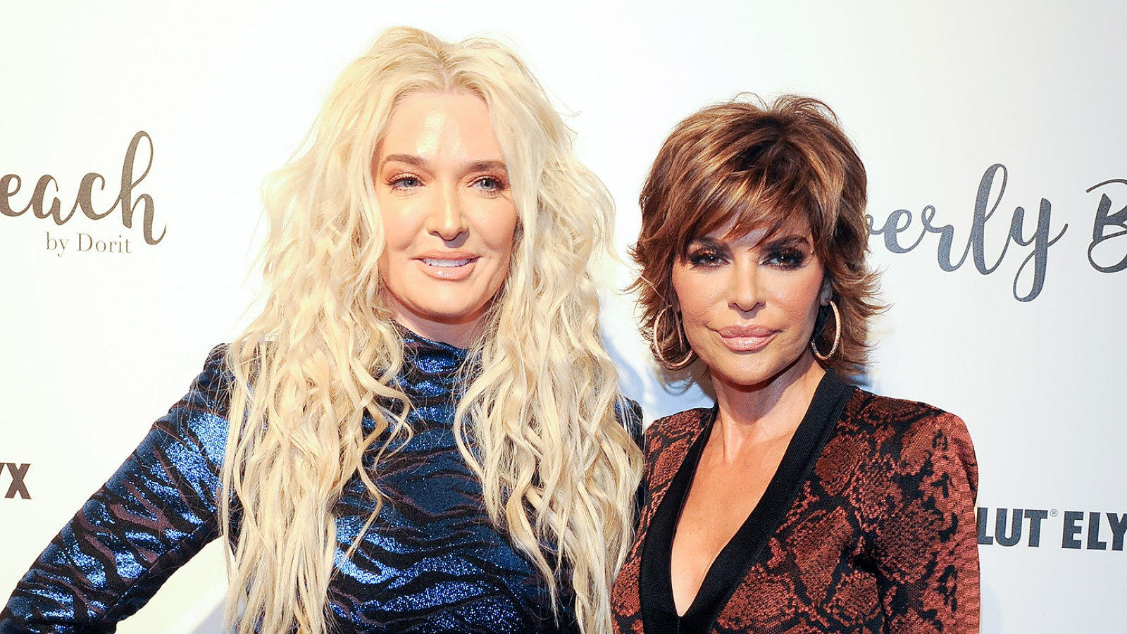 3a848776b689c Lisa Rinna and Erika Jayne Throw Shade at  RHOBH  Costar Who Won t Take  Group Pics — Who Are They Talking About