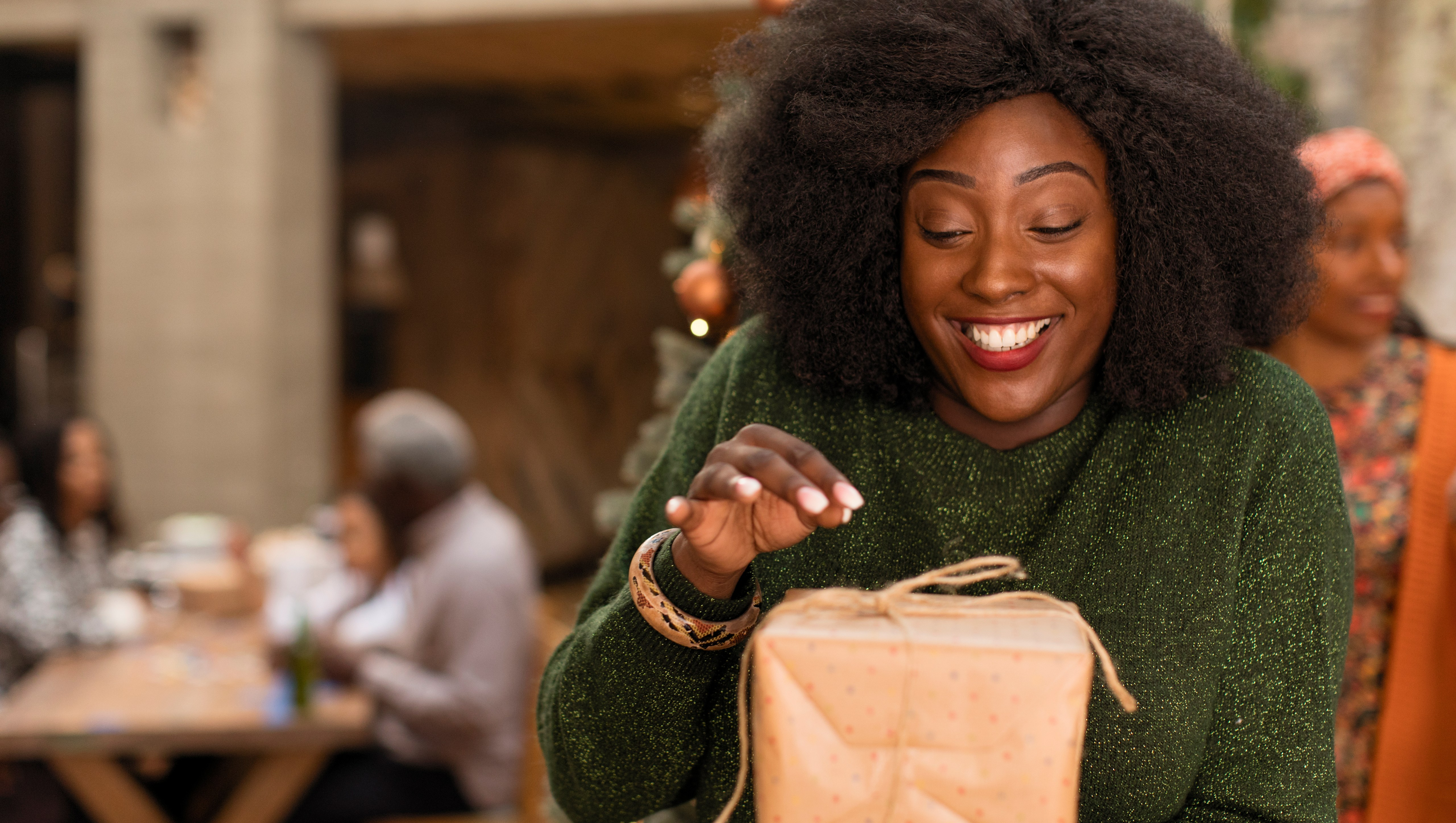 woman opening gifts