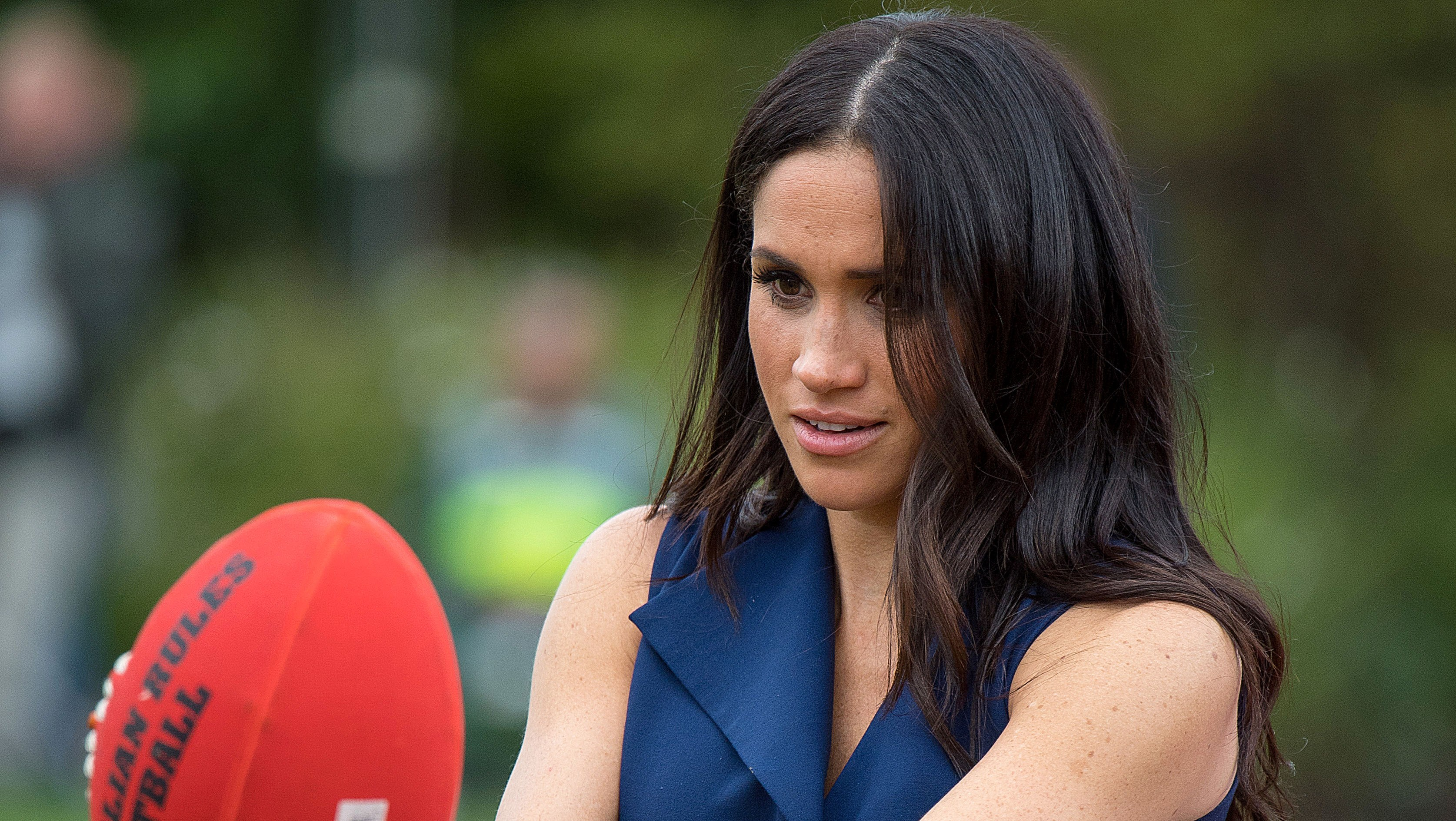 Pregnant Meghan Markle Plays Football