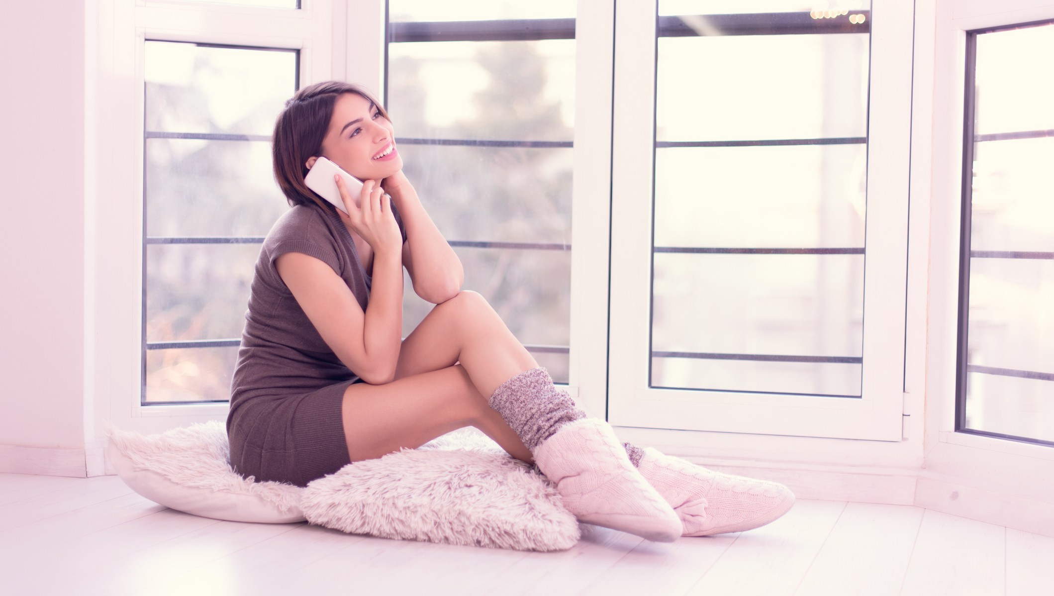 girl lounging in slippers