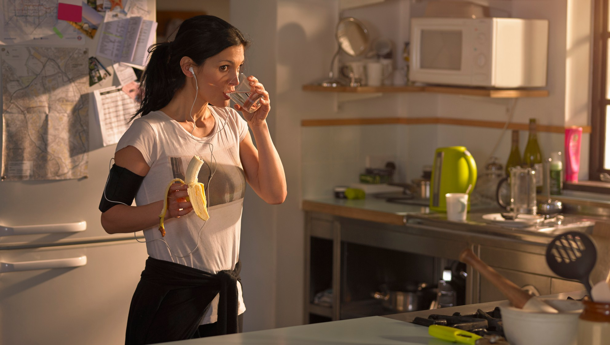 Woman in the kitchen preparing for run