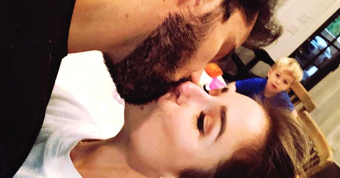 Jessie James Decker and Husband Eric Decker 'Sneak' in a Kiss While Their Son Looks On