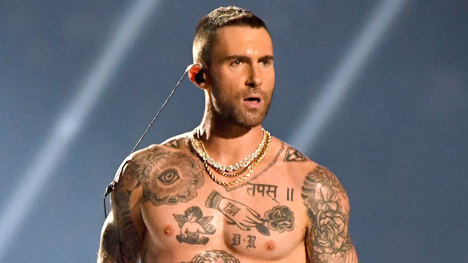 d9b56174 Twitter Is Convinced Adam Levine's Chest Tattoo Spells 'Bro' With His Nipple  as the 'O'