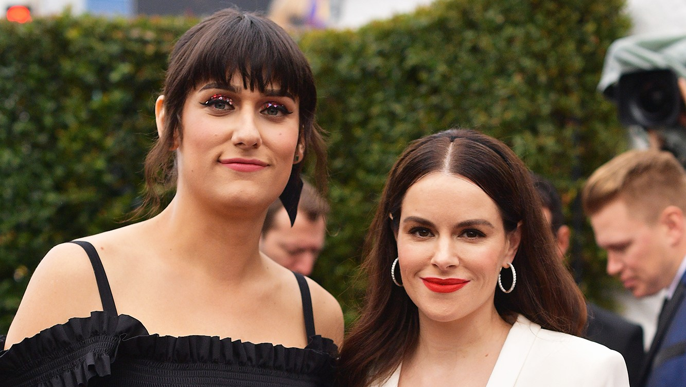 teddy geiger and fiancée Emily Hampshire walk the red carpet at the 2019 Grammys