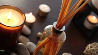 Close up of a bottle of fragrance diffuser with reeds.