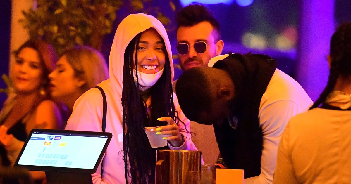 Moving On? Jordyn Woods Cuddles Up to Mystery Man at Coachella: Pics