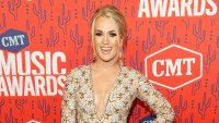 Carrie Underwood Smiling Red Carpet Wearing Low Cut Short Dress Attends 2019 CMT Music Awards
