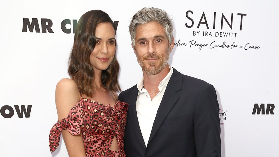 Odette Annable Wearing a Black Skirt and Multi Color Topa nd Dave Annable With White Shirt and Suit