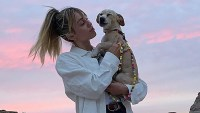 Miley Cyrus Hikes and Gets Massage With Her Dog Bean