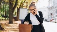 woman looking for something in handbag