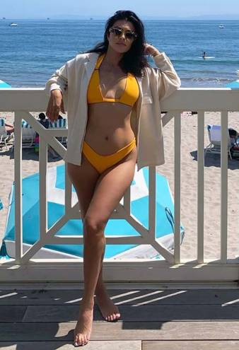 Kourtney Kardashian Wears the Most Flattering Orange Bikini