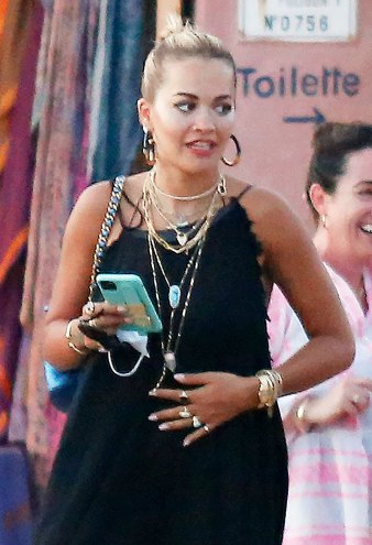 Rita Ora Teeny Bikini Bottoms Peek Out of Her Stylish Cover-Up