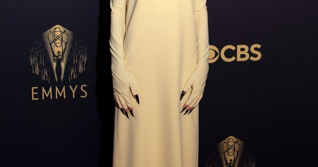 Swim Cap! Black Claws! Emma Corrin's 2021 Emmys Outfit Sparks the Funniest 'Crucible' Comparisons.jpg