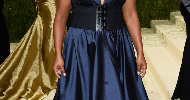 Mindy Kaling Arrives at the 2021 Met Gala in Jewel-Toned Tory Burch.jpg