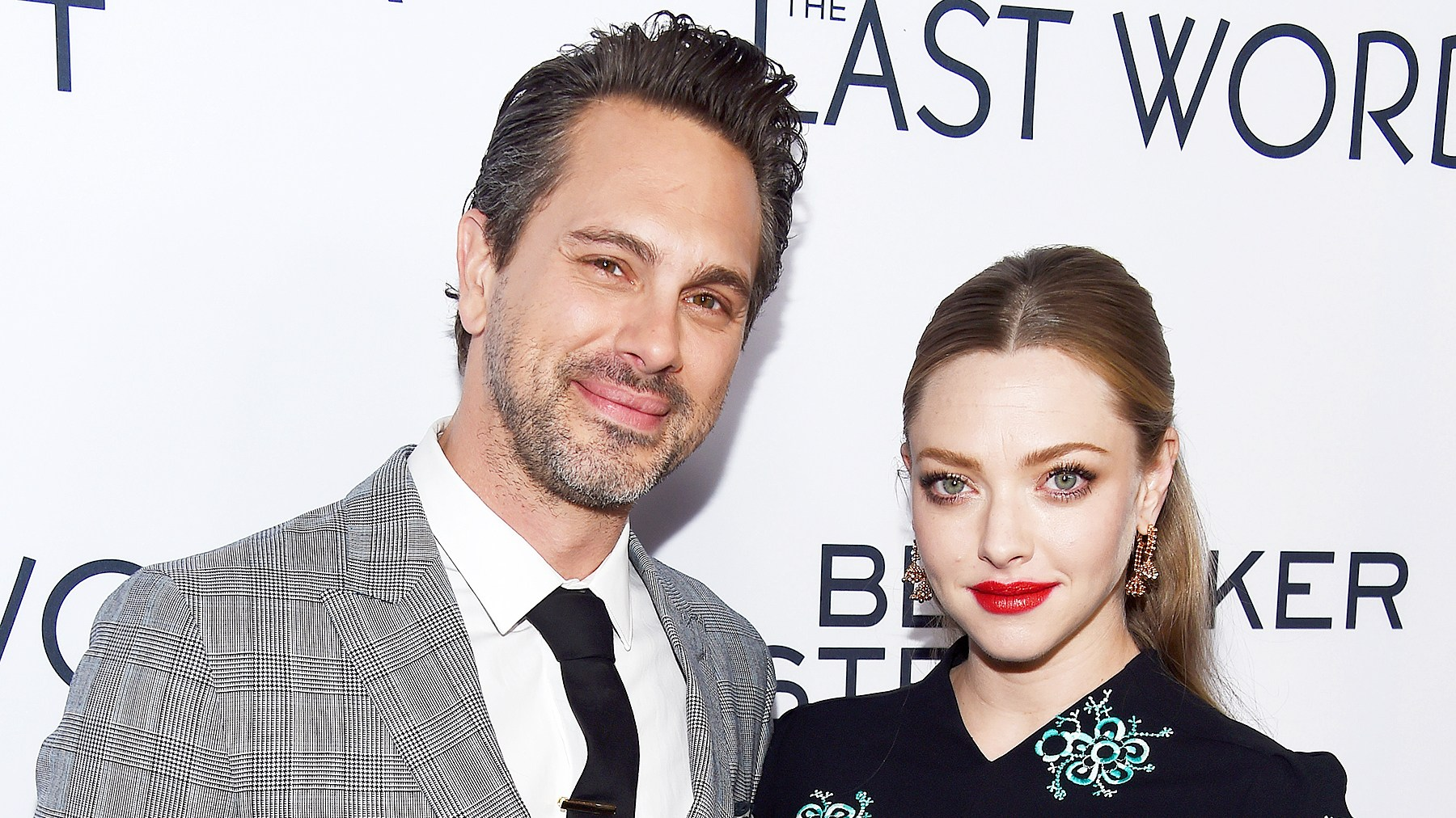 """Thomas Sadoski and Amanda Seyfried arrive at the premiere of Bleecker Street Media's """"The Last Word"""" at ArcLight Hollywood on March 1, 2017 in Hollywood, California."""