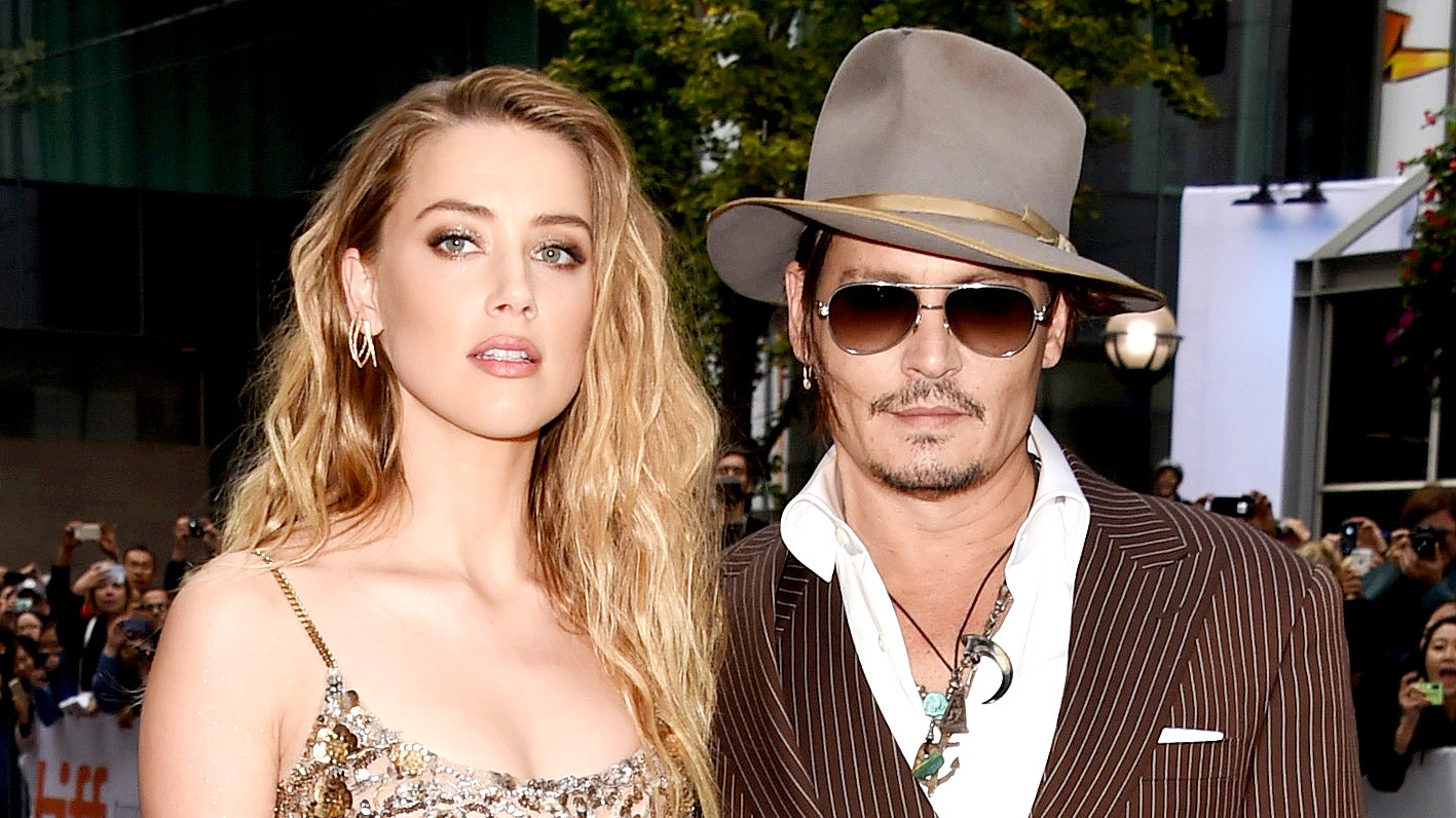 "Amber Heard and Johnny Depp attend ""The Danish Girl"" premiere during the 2015 Toronto International Film Festival."