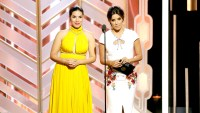 America Ferrera and Eva Longoria speak onstage during the 73rd Annual Golden Globe Awards.
