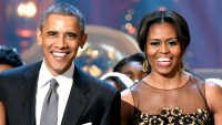 Barack Obama and Michelle Obama speak onstage at TNT Christmas in Washington 2014 at the National Building Museum on December 14, 2014 in Washington, DC.