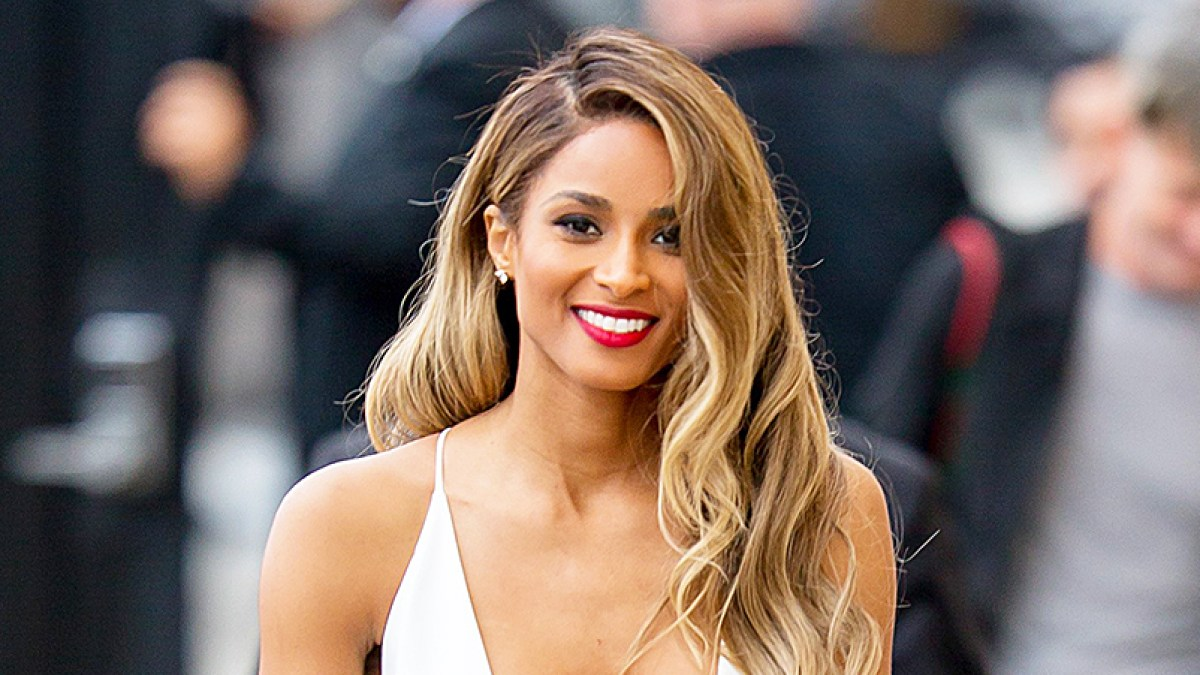 60da3975 Ciara Stuns in Plunging White Dress With High Slit: Photos