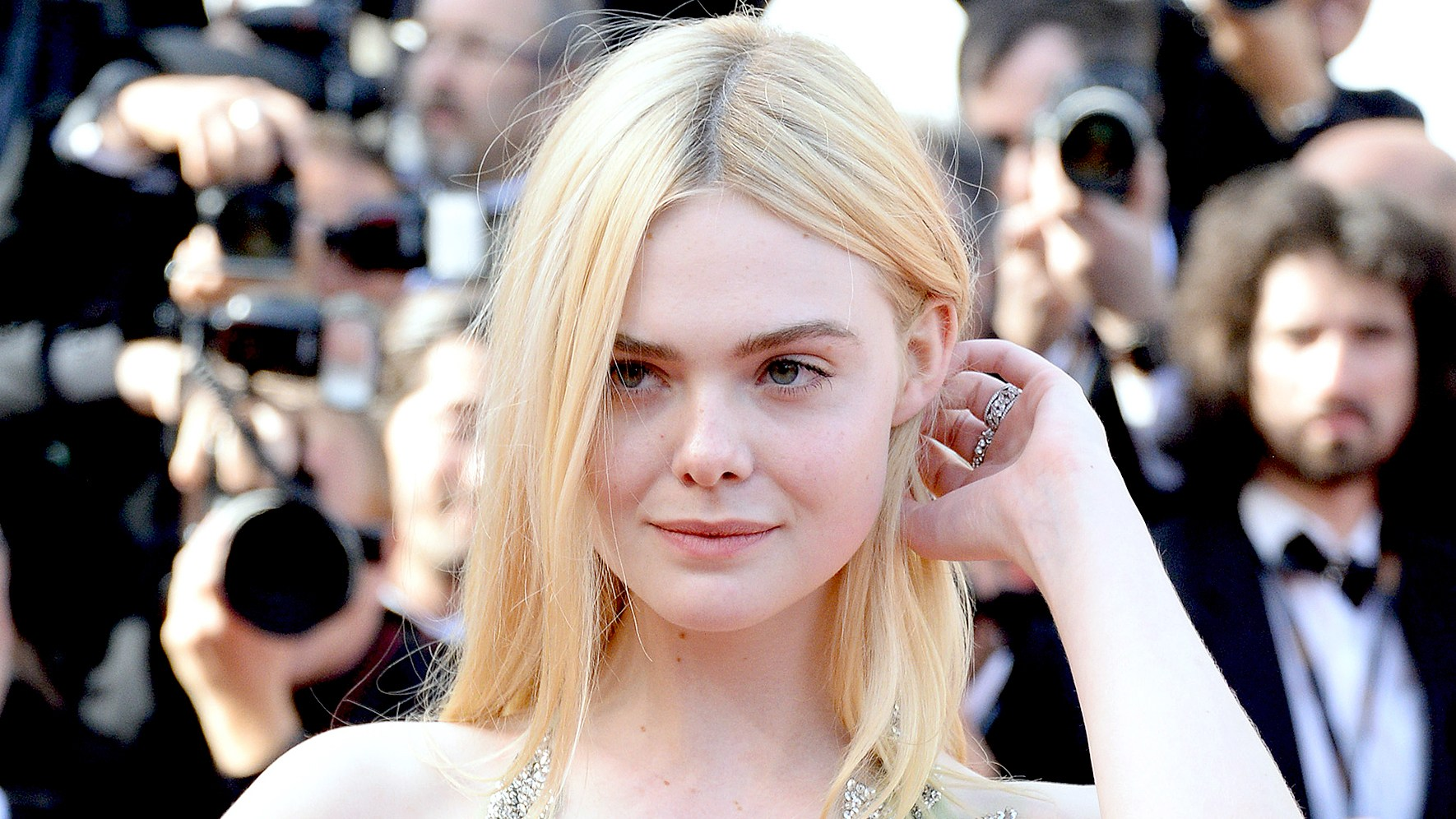 "Elle Fanning departs after the ""How To Talk To Girls At Parties"" screening during the 70th annual Cannes Film Festival at Palais des Festivals on May 21, 2017 in Cannes, France."