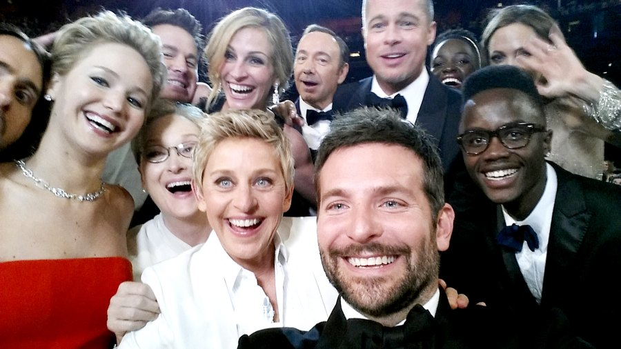 Ellen DeGeneres poses for a selfie taken by Bradley Cooper with (clockwise from L-R) Jared Leto, Jennifer Lawrence, Channing Tatum, Meryl Streep, Julia Roberts, Kevin Spacey, Brad Pitt, Lupita Nyong'o, Angelina Jolie, Peter Nyong'o Jr. and Bradley Cooper during the 86th Annual Academy Awards at the Dolby Theatre on March 2, 2014 in Hollywood, California.
