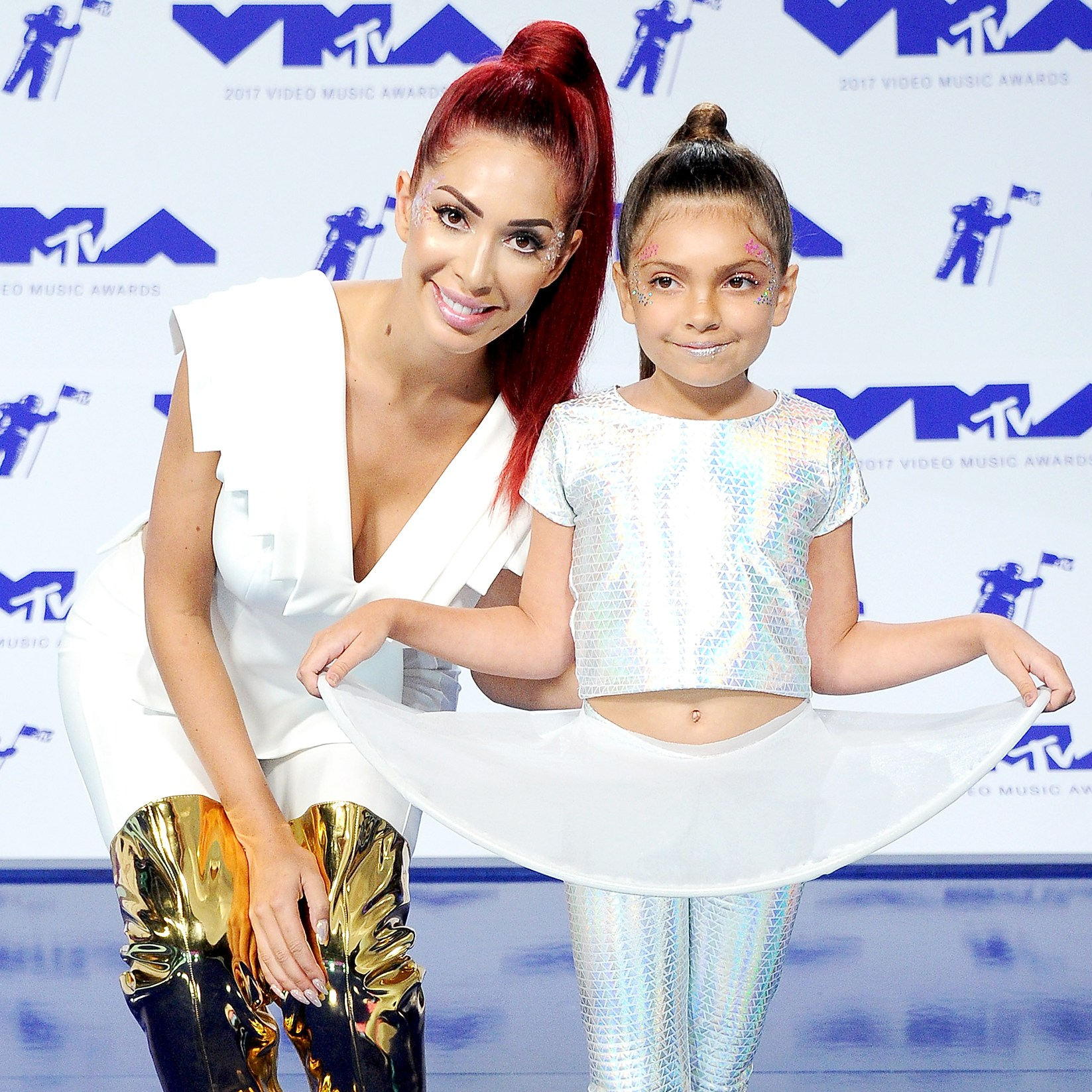 Farrah Abraham and daughter arrive at the 2017 MTV Video Music Awards at The Forum on August 27, 2017 in Inglewood, California.