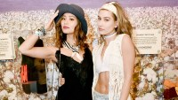 Jamie Chung and Hailey Baldwin attend the H&M Loves Coachella Pop UP at The Empire Polo Club on April 15, 2016 in Indio, California.