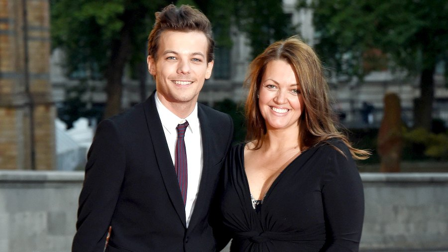 Louis Tomlinson and Johannah Poulston attend the Believe in Magic Cinderella Ball at Natural History Museum on August 10, 2015 in London, England.