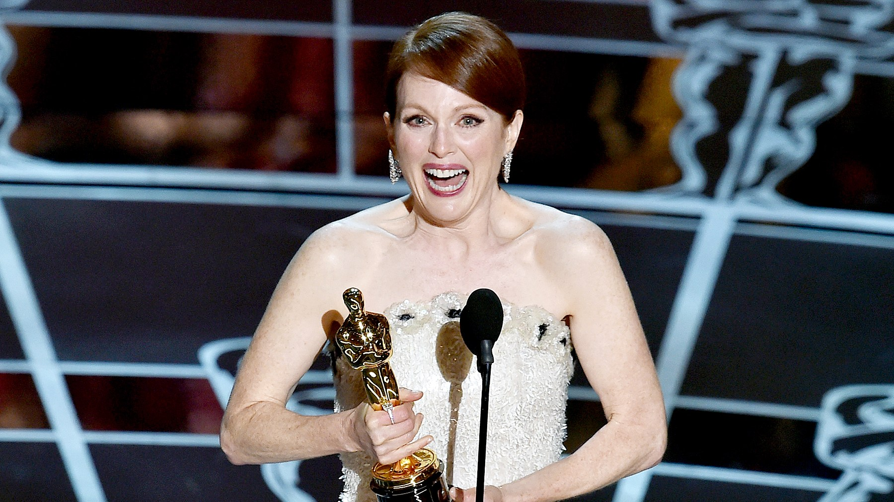 Julianne Moore accepts the Best Actress in a Leading Role award for 'Still Alice' on stage during the 87th annual Academy Awards.