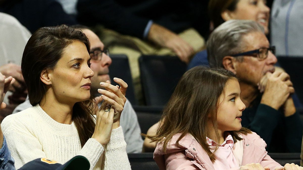 Katie Holmes and Suri Cruise watch a Notre Dame game