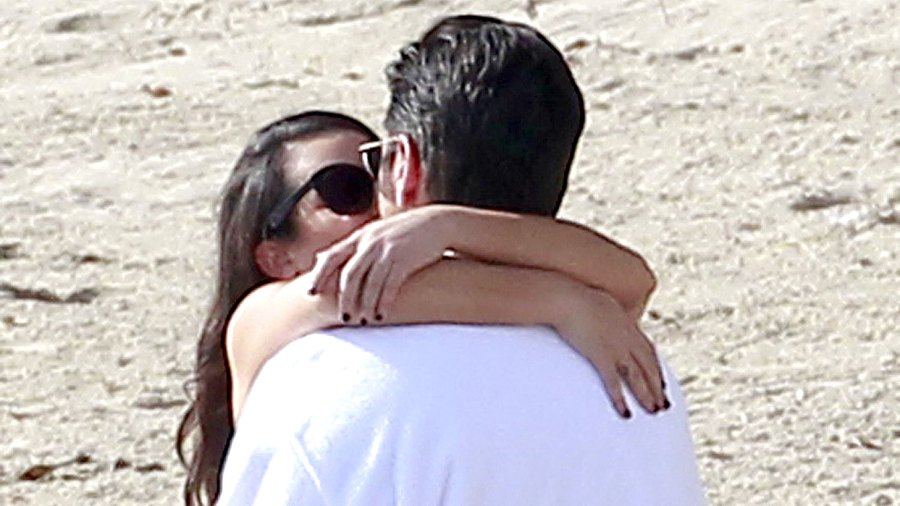 Lea Michele and John Stamos share a saucy seaside kiss whilst filming the season 2 finale of Scream Queens in Malibu.