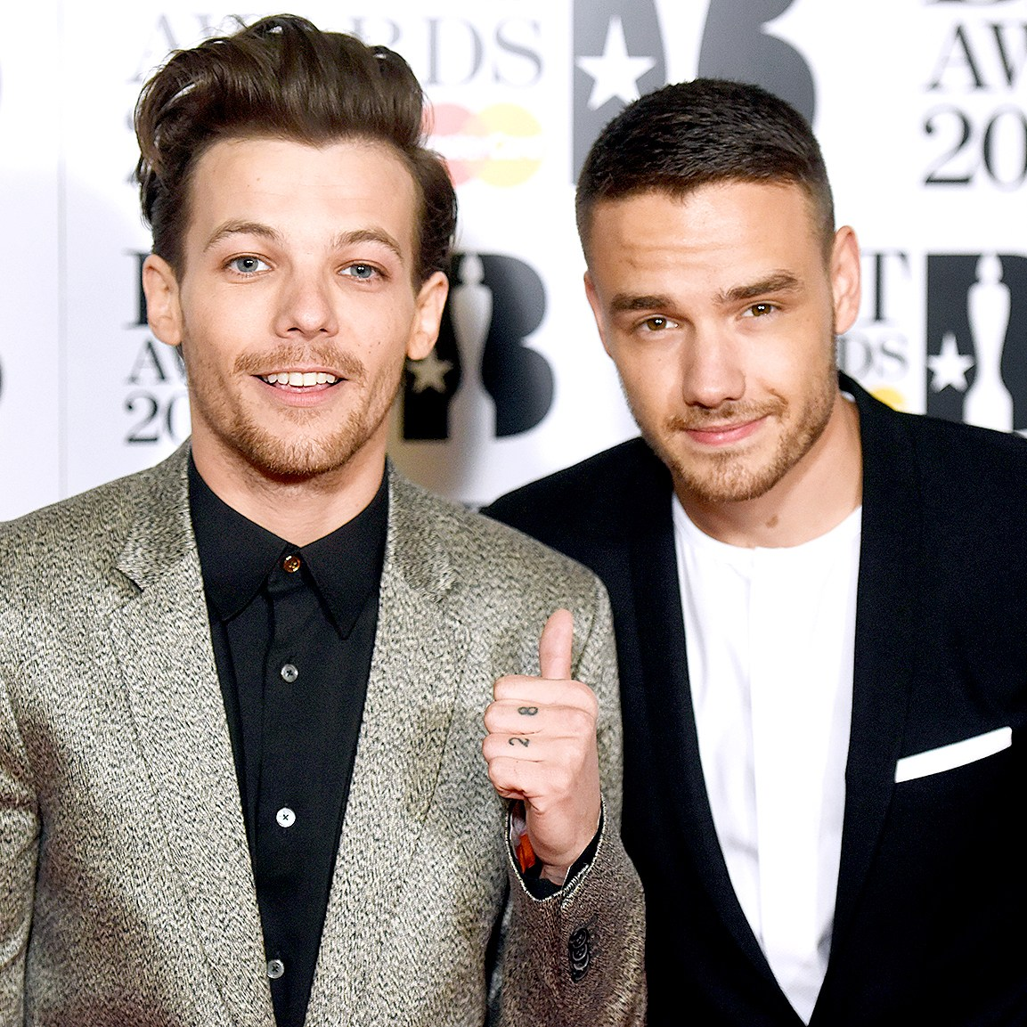 Louis Tomlinson and Liam Payne attend the BRIT Awards 2016 at The O2 Arena on February 24, 2016 in London, England.