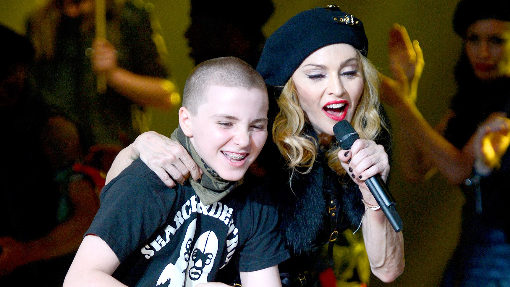 """Rocco Ritchie and Madonna perform on stage during her """"MDNA"""" tour at Ramat Gan Stadium on May 31, 2012 in Tel Aviv, Israel."""