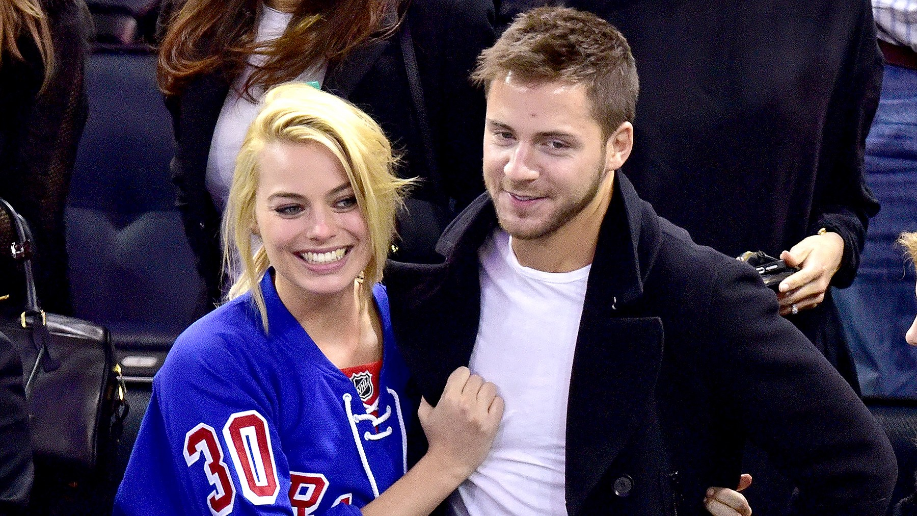 Margot Robbie and Tom Ackerley attend the Arizona Coyotes vs New York Rangers game at Madison Square Garden in New York City on February 26, 2015.