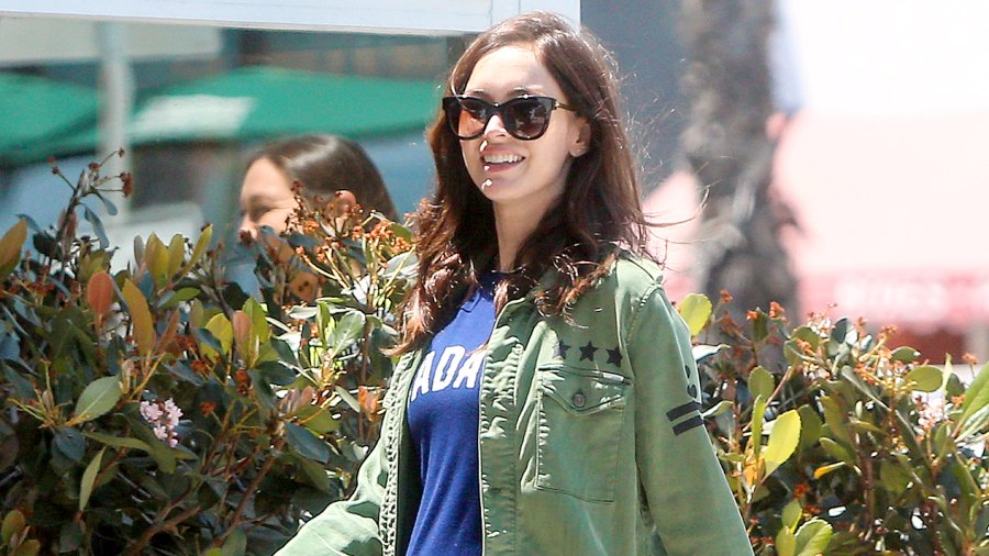 Megan Fox sports a growing baby bump while spotted out amid news she and husband Brian Austin Green are expecting their third child together.